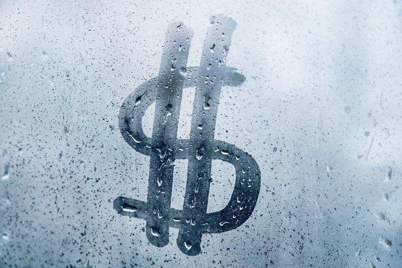 znak dolara na szybie